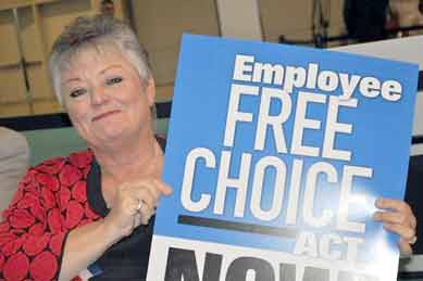 Becky Moeller with Employee Free Choice sign